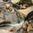 Stones in river - Stock Photo