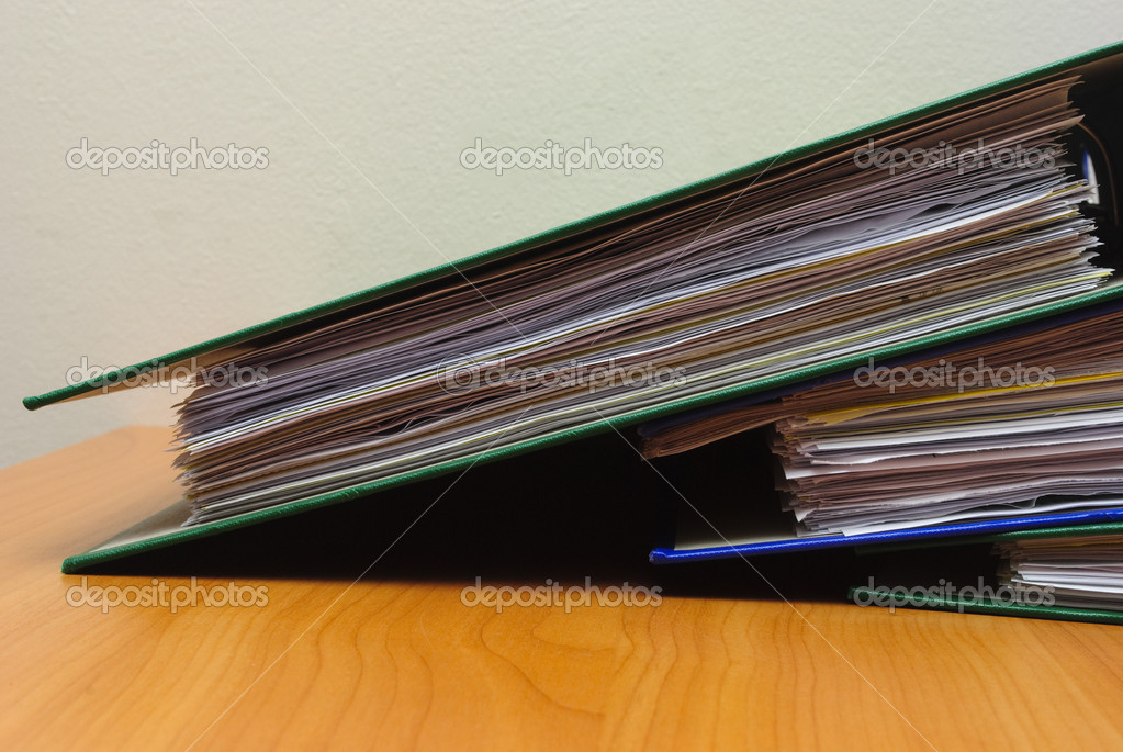 Stack of documents in folders on office desktop close-up. Shallow deep of field — Stock Photo #1726565