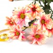 Pink daisy with gold ribbon — Stock Photo