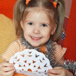 The happy girl with a paper snowflake — Stock Photo