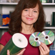 Stock Photo: The seller of compact discs