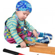 Royalty-Free Stock Photo: The kid plays with tools