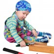 The kid plays with tools - Stock Photo