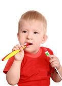 The child is trained to clean a teeth — Stock Photo