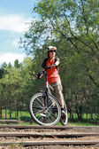 The bicyclist in old park — Stock Photo