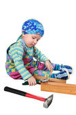 The kid plays with tools — Stock Photo
