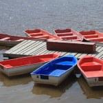 Bright boats at a river mooring — Stock Photo