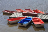 Bright boats at a river mooring — Stock Photo