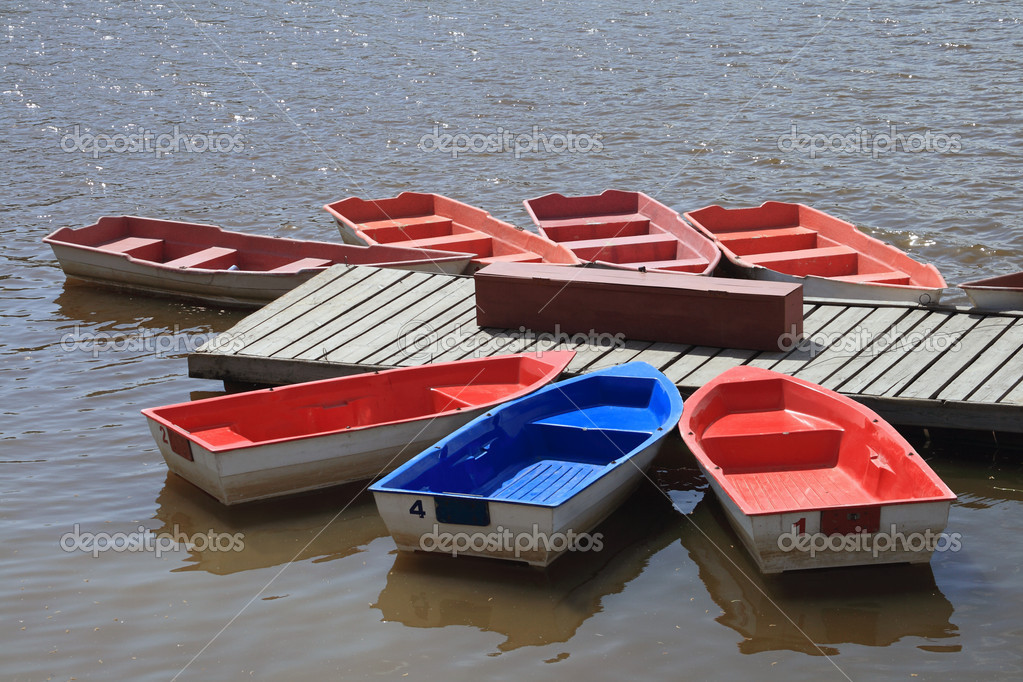 Summer landscape - colorful boats docked  Stock Photo #1123691