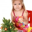 Enthusiastic girl dresses up Christmas t — Stock Photo