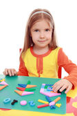 Girl makes Christmas applique — Stock Photo
