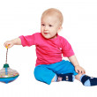 Child plays with whirligig — Stock Photo