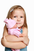 The girl with a favourite doll — Stock Photo