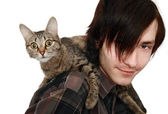 The young man with a cat — Stock Photo