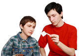TWO BROTHERS ARE CONSIDERING STAMPS — Stock Photo