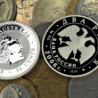Silver and usual coins - Stock Photo