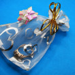 Stock Photo: Transparent gift packing with gold rin