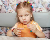 The girl studies to paint nails — Stock Photo