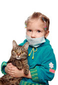The sad ill girl with a cat — Stock Photo