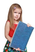 The girl shows a writing-book — Stock Photo