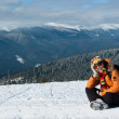 Young snowboarder resting — Stock Photo