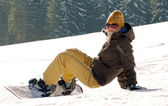 Snowboard girl on a hill — Stock Photo