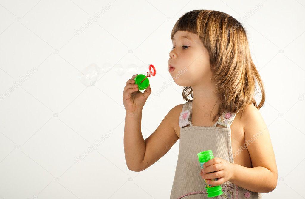 Girl Blowing Soap Bubbles Girl Blowing Soap Bubbles