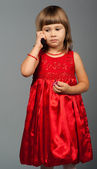 Cute little girl listening to the phone — Stock Photo