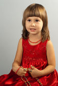 Cute little girl in a red dress — Stock Photo