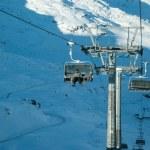 Skier on a ski lift — Stock Photo
