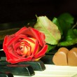 Royalty-Free Stock Photo: Rose and chocolate hearts in a piano
