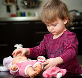 Little girl with a doll — Stock Photo