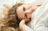 Beautiful young woman lying down — Stock Photo