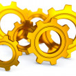 Gold Gearwheels - Stock Photo