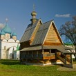 Wooden church and white stone cathedral. — Stock Photo