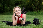Woman talks on a mobile phone — Stock Photo