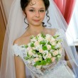 Young bride with wedding bouquet — Stock Photo
