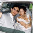 Bride and groom in the car — Stock Photo