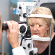 Doctor, and patient in ophthalmology lab - Stockfoto