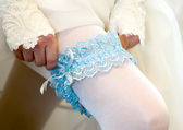 Blue wedding garter from the bride — Stock Photo
