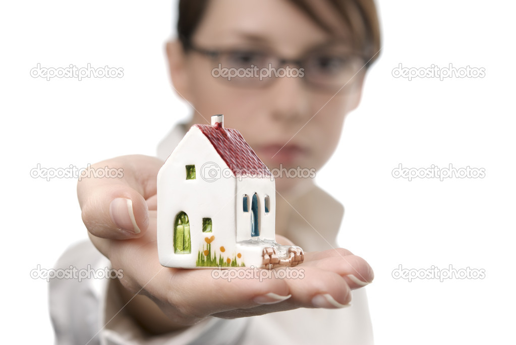 Image of business woman holding toy house on her palm — Stock Photo #1226992