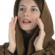 Young woman in a hood colling — Stock Photo
