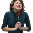 Young woman holding her lollipop — Stock Photo