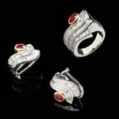 Two silver earrings and ruby ring — Stock Photo
