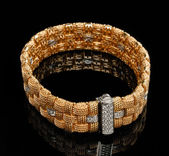Golden bracelet with diamonds — Stock Photo