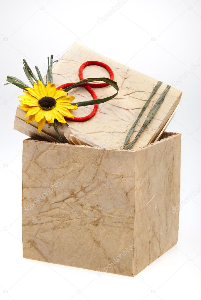 Gift box with number 8 and flower on cover, isolated on white background — Stock Photo #1345508