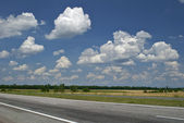 Empty road and cloudy sky — Stock Photo