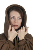 Cheerful young woman holding her hood — Stock Photo