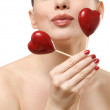 Beautiful woman holding two red hearts. — Stock Photo