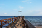 Cross on pier — Stock Photo